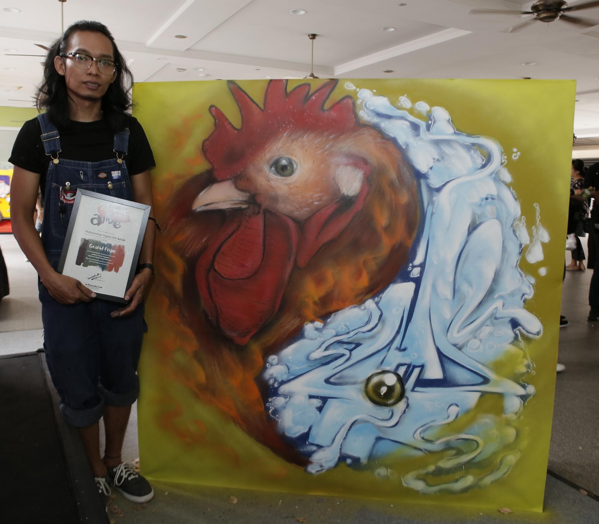 Muhammad Khairy Bin Ishak with his winning artwork