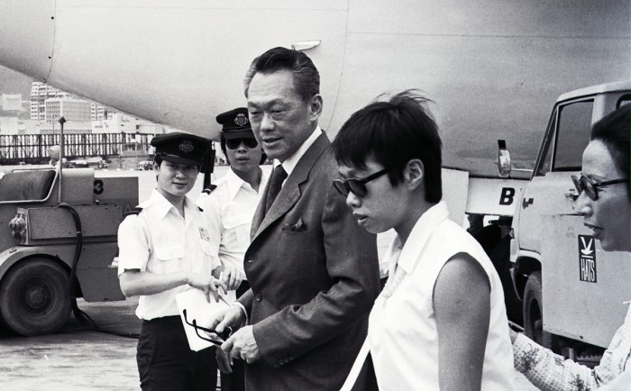 Lee Kuan Yew (in suit), Singapore's Prime Minister, with his wife (left) and daughter (in vest) stopping over in Hong Kong after a secret visit to Taiwan.