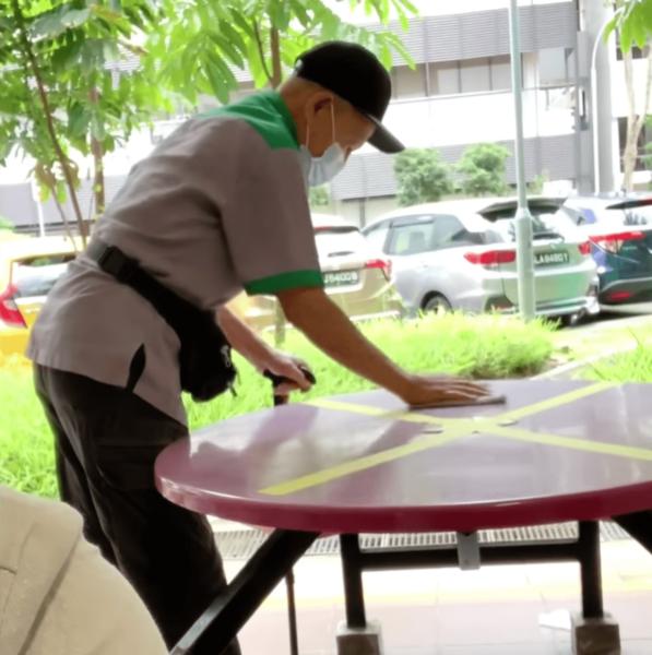 elderly cleaner contented